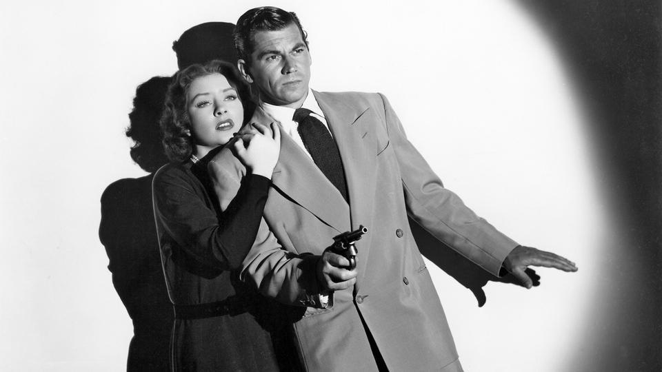 Amanda Blake and Ron Randell in Counterspy Meets Scotland Yard (1950)