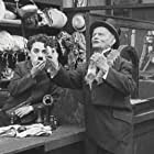 Charles Chaplin and Wesley Ruggles in The Pawnshop (1916)