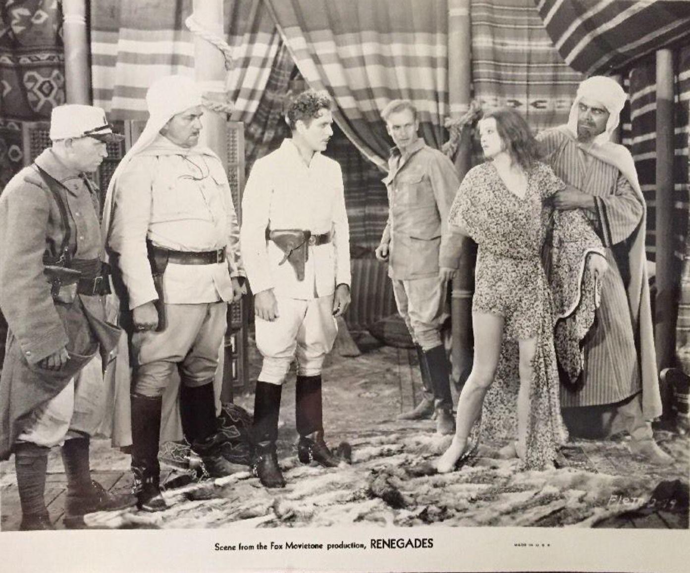Myrna Loy, Noah Beery, Warner Baxter, and Gregory Gaye in Renegades (1930)
