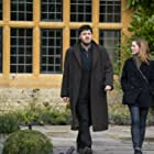 Tom Burke and Holliday Grainger in Lethal White: Part 3 (2020)