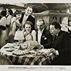 Mary Brian, Warner Oland, and Erik Rhodes in Charlie Chan in Paris (1935)