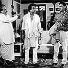 Gulshan Grover, Kader Khan, and Rajinikanth in Tyagi (1992)