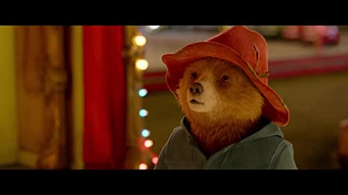 While searching for the perfect present for his beloved Aunt Lucy's hundredth birthday, Paddington sees a unique pop-up book in Mr. Gruber's antique shop, and embarks upon a series of odd jobs to buy it.  But when the book is stolen, it's up to Paddington and the Browns to unmask the thief.