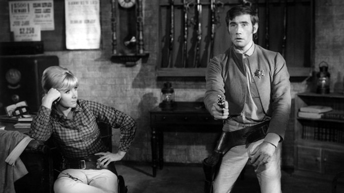 Jim Dale and Angela Douglas in Carry On Cowboy (1965)