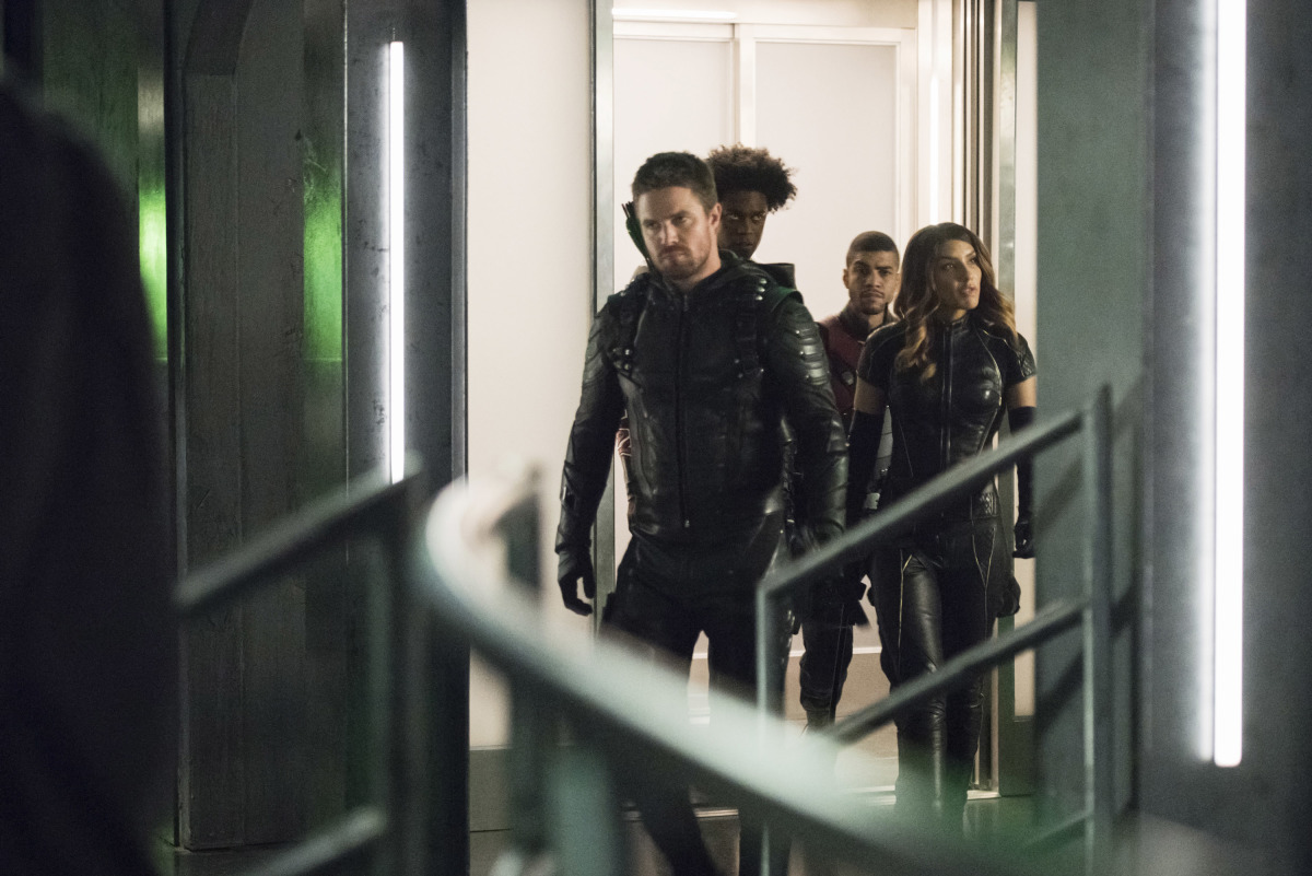 Rick Gonzalez, Stephen Amell, Juliana Harkavy, and Echo Kellum in Arrow (2012)