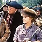 Robert Taylor, Victor McLaglen, Ralph Moody, Eleanor Parker, and Rhys Williams in Many Rivers to Cross (1955)