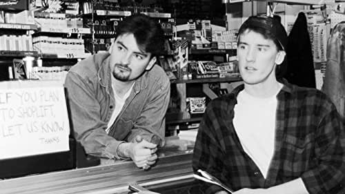 A day in the lives of two convenience clerks named Dante and Randal as they annoy customers, discuss movies, and play hockey on the store roof.