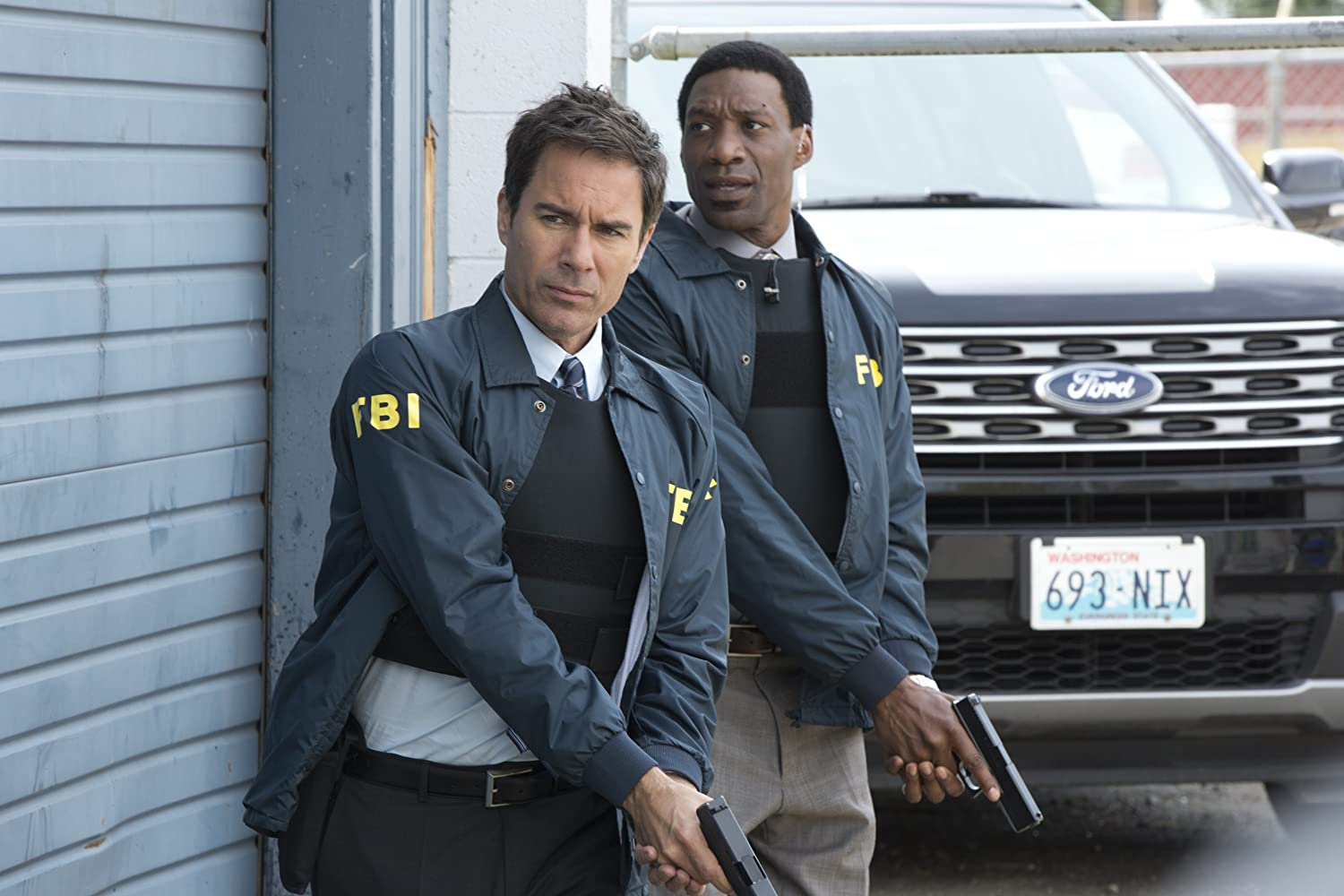 Eric McCormack and Arnold Pinnock in Travelers (2016)