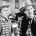Ernie Adams and Karl Hackett in Riding the Wind (1942)