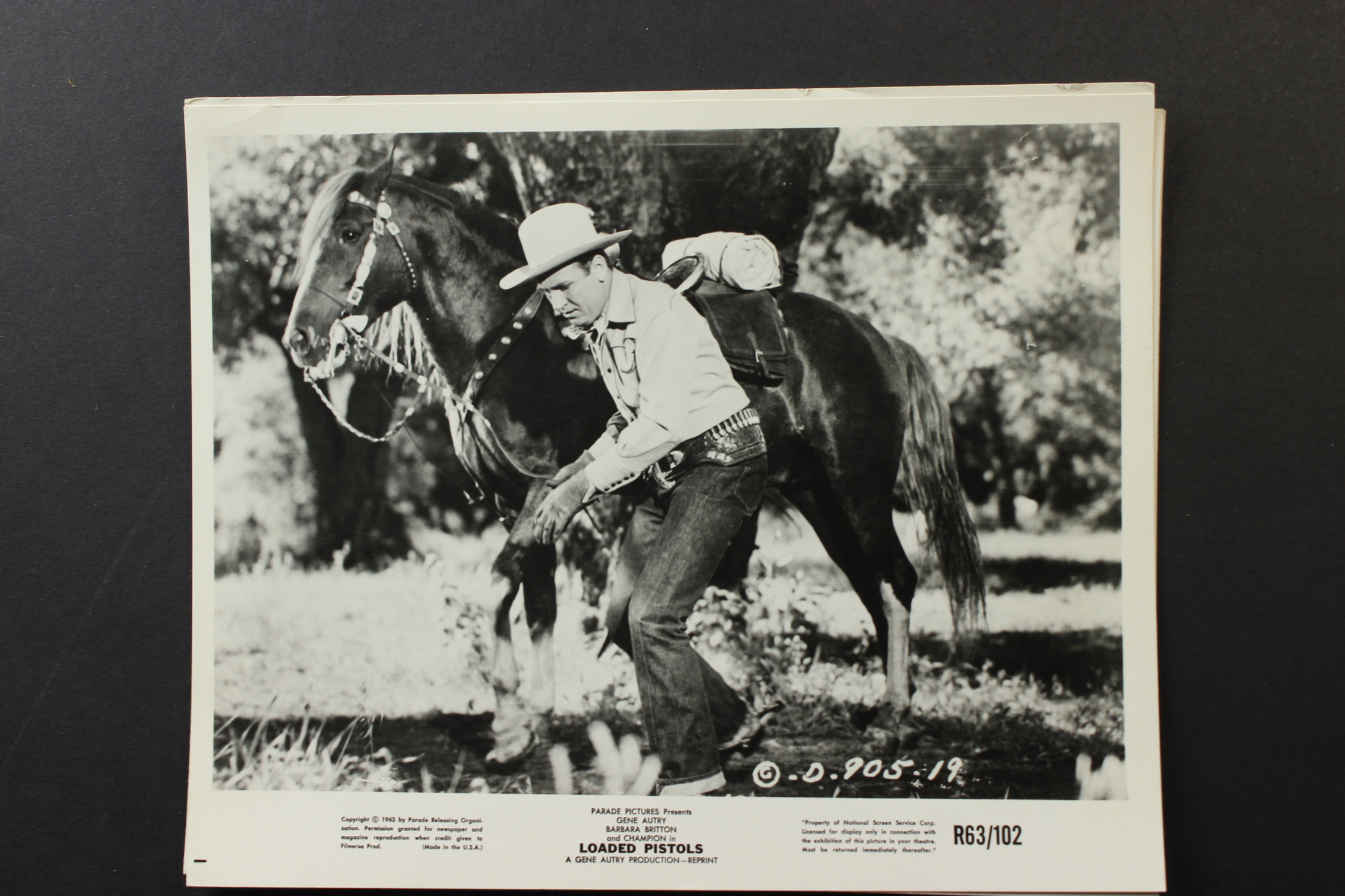 Gene Autry and Champion in Loaded Pistols (1948)