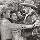 Roy Rogers, Stanley Andrews, Lynne Roberts, Myrtle Wiseman, and Scotty Wiseman in Shine on Harvest Moon (1938)