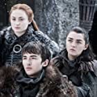 Maisie Williams, Isaac Hempstead Wright, and Sophie Turner in Game of Thrones (2011)