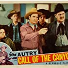Gene Autry, Smiley Burnette, Thurston Hall, Joe Strauch Jr., and Eddy Waller in Call of the Canyon (1942)