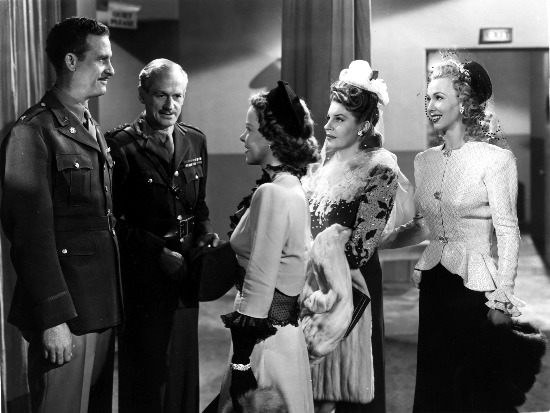 Warren Ashe, William Forrest, Carole Landis, Mitzi Mayfair, and Martha Raye in Four Jills in a Jeep (1944)