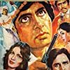 Amitabh Bachchan, Shashi Kapoor, and Parveen Babi in Namak Halaal (1982)