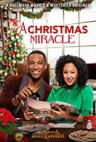 Tamera Mowry-Housley and Brooks Darnell in A Christmas Miracle (2019)