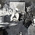 Kenne Duncan, John 'Dusty' King, David Sharpe, Max Terhune, and Elmer in Texas to Bataan (1942)