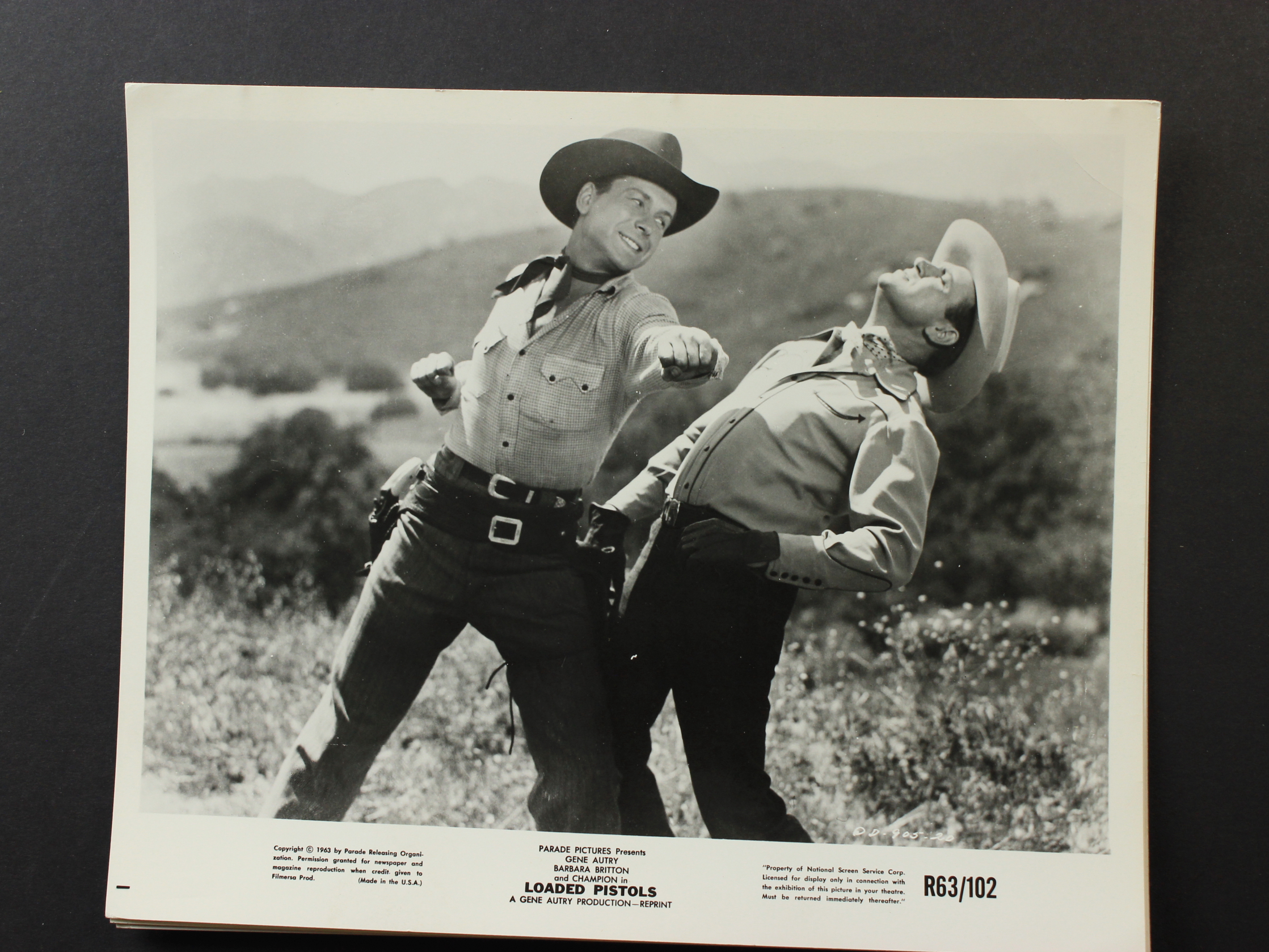 Gene Autry and Russell Arms in Loaded Pistols (1948)