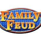 John Enos III, Richard Karn, and Burton Richardson in Family Feud (1999)