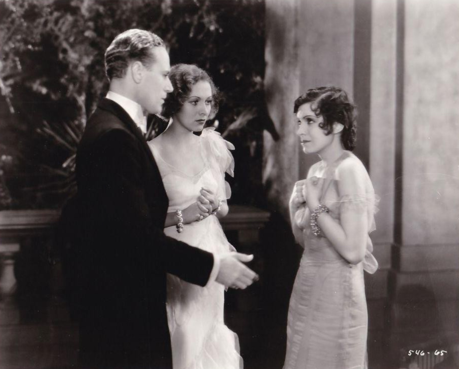 Leslie Howard, Conchita Montenegro, and Karen Morley in Never the Twain Shall Meet (1931)