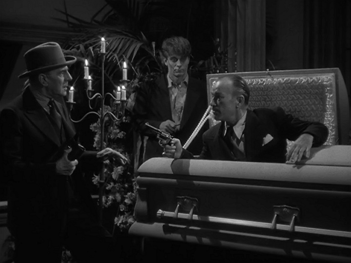 Robert Armstrong, David Bruce, and George Zucco in The Mad Ghoul (1943)