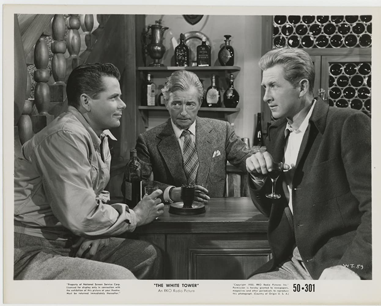 Lloyd Bridges, Glenn Ford, and Claude Rains in The White Tower (1950)