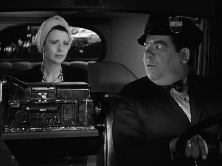 Bess Flowers and Frank Mills in You'll Find Out (1940)