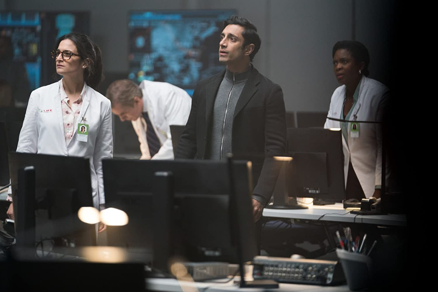 Riz Ahmed, Jenny Slate, and Sope Aluko in Venom (2018)