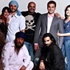 Director Puneet Sira (centre) with his cast of Kisaan (2009). Top row from L to R: Nauheed Cyrusi, Sohail Khan, Puneet Sira (director), Arbaaz Khan and Dia Mirza. Below from L to R: Jackie Shroff and Romeo Sharma.