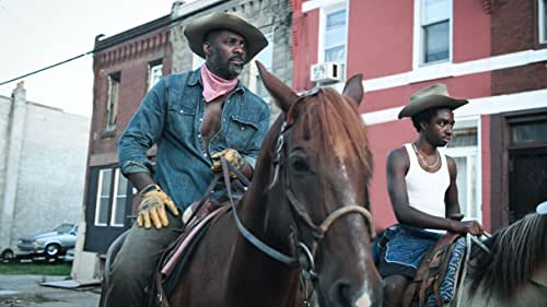 """While spending the summer in North Philadelphia, a troubled teen (Caleb McLaughlin) is caught between a life of crime and his estranged father's (Idris Elba) vibrant urban-cowboy subculture. Inspired by the novel 'Ghetto Cowboy' by G. Neri, Concrete Cowboy is directed by Ricky Staub and co-stars Jharrel Jerome, Byron Bowers, Lorraine Toussaint and Clifford """"Method Man"""" Smith. On Netflix April 2."""