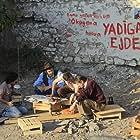 Mustafa Uzunyilmaz, Volga Sorgu, Orhan Eskin, and Ferit Kaya in Bu Son Olsun (2012)