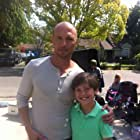 Jake as Tommy Sikes,  on set with actor Luke Goss on feature film April Rain.