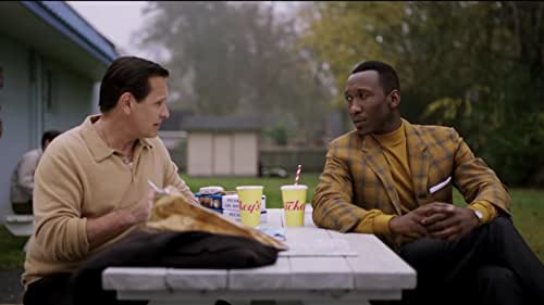 """When Tony Lip (Viggo Mortensen), a bouncer from an Italian-American neighborhood in the Bronx, is hired to drive Dr. Don Shirley (Mahershala Ali), a world-class Black pianist, on a concert tour from Manhattan to the Deep South, they must rely on """"The Green Book"""" to guide them to the few establishments that were then safe for African-Americans.  Confronted with racism, danger-as well as unexpected humanity and humor-they are forced to set aside differences to survive and thrive on the journey of a lifetime."""