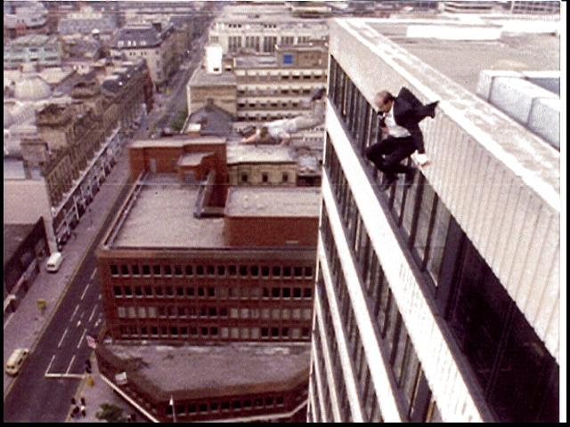 Marc Cass performing a 100 foot high fall off the top of the Ramada hotel in Manchester