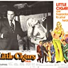 Billy Curtis and Angel Tompkins in Little Cigars (1973)