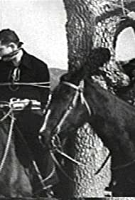Silver Tip Baker, Reb Russell, and Rebel in Blazing Guns (1935)