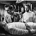 Christopher Lee, Peter Cushing, and Robert Urquhart in The Curse of Frankenstein (1957)
