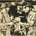 Robert Taylor, Alex Havier, and George Murphy in Bataan (1943)