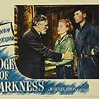 Errol Flynn, Walter Huston, and Ann Sheridan in Edge of Darkness (1943)