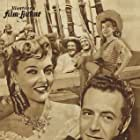 Paul Henreid, Mary Anderson, and Karin Booth in Last of the Buccaneers (1950)