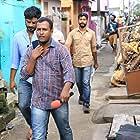 Abinandhan Ramanujam, Jijo Antony, and Kiran Raphel in Darvinte Parinamam (2016)