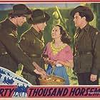 Betty Bryant, Chips Rafferty, and Pat Twohill in 40,000 Horsemen (1940)