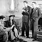Jim Bannon, Jeff Donnell, Mark Roberts, and Barton Yarborough in The Unknown (1946)