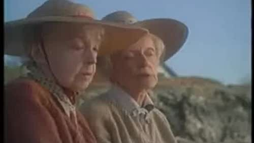 Two aged sisters reflect on life and the past during a late summer day in Maine.