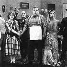 Buster Keaton, Roscoe 'Fatty' Arbuckle, Alice Mann, and Al St. John in His Wedding Night (1917)