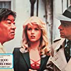 Misty Rowe, Robert Sacchi, and Victor Sen Yung in The Man with Bogart's Face (1980)