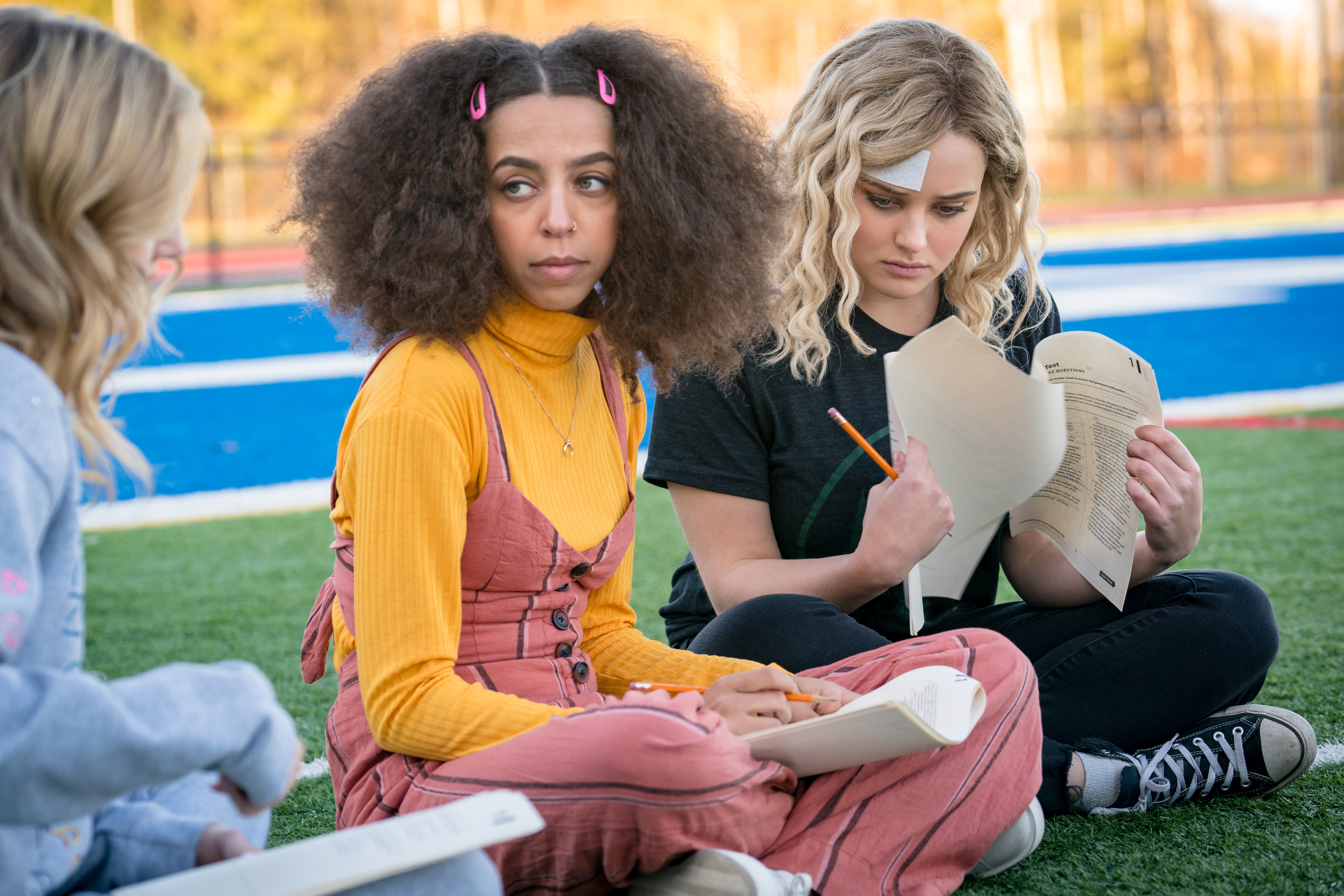 Katherine Langford and Hayley Law in Spontaneous (2020)