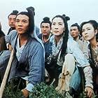 Michelle Yeoh, Jet Li, Fennie Yuen, and Yankai Yu in Tai gik Cheung Sam Fung (1993)