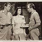 Joan Bennett, Douglas Fairbanks Jr., and John Howard in Green Hell (1940)