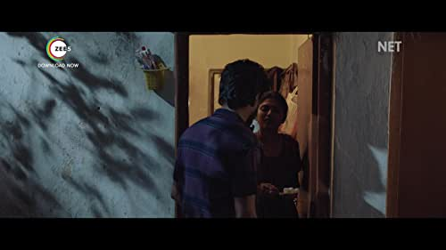After an online subscription-based surveillance agency lets Laxman, a married man, watch the life of Priya, a young girl, through hidden cameras, his obsession towards Priya puts him in a complex situation. Watch this gripping ZEE5 Original film. Premieres 10th September 2021.